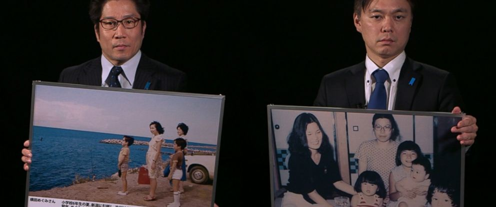 PHOTO: Takuya Yokota,left, and Koichiro Iizuka, right, hold up photos of their sister and mother, respectively, who were allegedly abducted by North Korea in the 1970s.