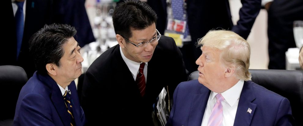 PHOTO: Japans Prime Minister Shinzo Abe, left, and U.S. President Donald Trump, right, talk prior to a working lunch at the Group of 20 (G-20) summit in Osaka, western Japan, Friday, June 28, 2019.