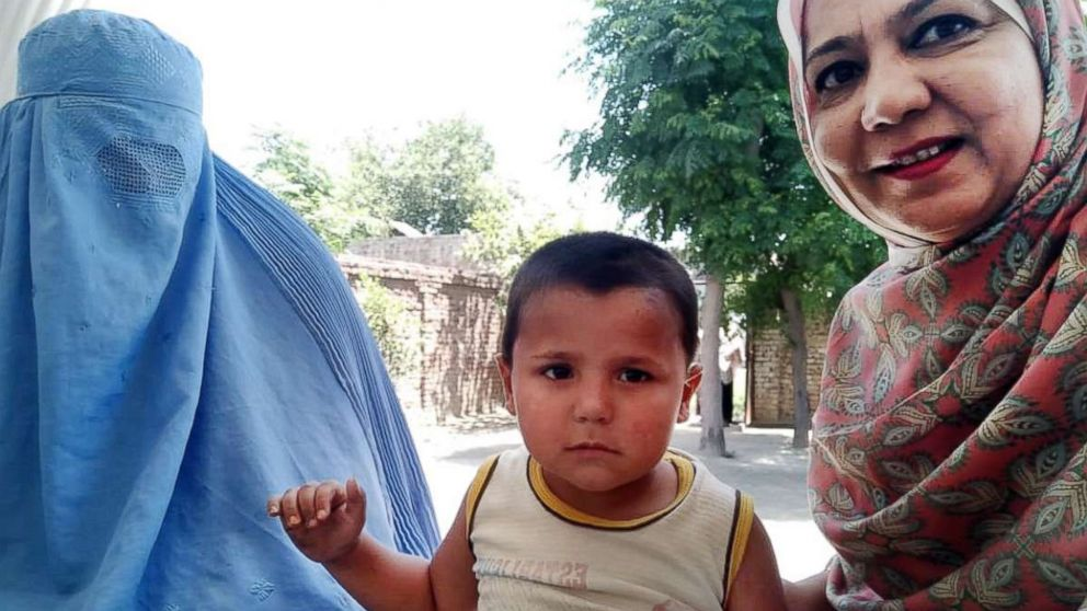 Abid Ullah (center) is seen with his mother, Khyal Baro (left), and Rotary International's Tayyaba Gul (right) in Nowshera district, Pakistan, May 24, 2018.