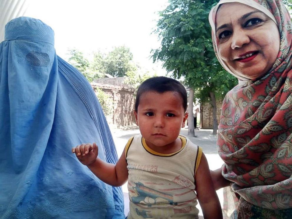 PHOTO: Abid Ullah (center) is seen with his mother, Khyal Baro (left), and Rotary Internationals Tayyaba Gul (right) in Nowshera district, Pakistan, May 24, 2018.