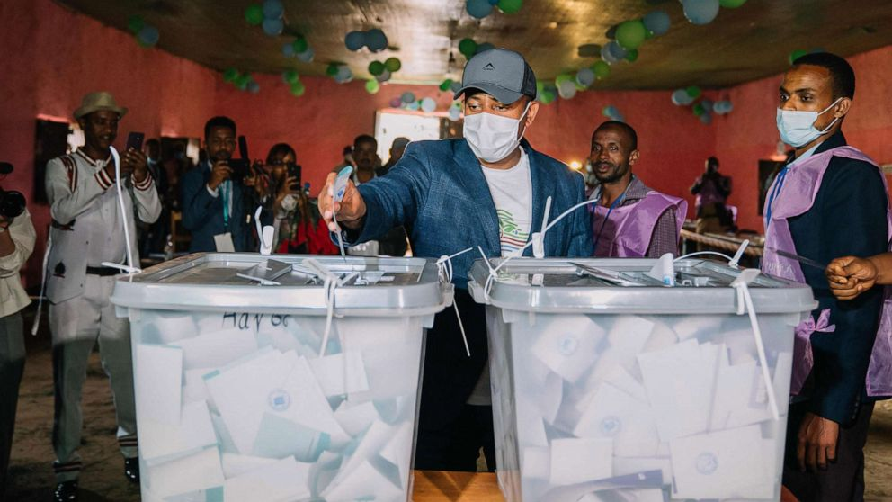 PHOTO: This handout picture taken and released by the Ethiopia Prime Minister Office in Beshasha, Ethiopia on June 21, 2021, shows Ethiopian Prime Minister Abiy Ahmed casting his ballot at a polling station.