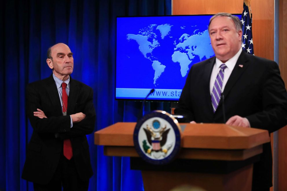 PHOTO: Elliott Abrams, left, listens to Secretary of State Mike Pompeo talk about Venezuela at the State Department in Washington D.C., Jan. 25, 2019.