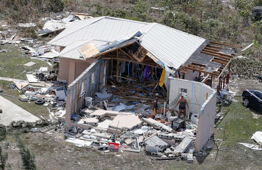 PHOTO: Residents look through the remains of a home after hurricane Dorian hit the Grand Bahama Island in the Bahamas, Sept. 4, 2019.