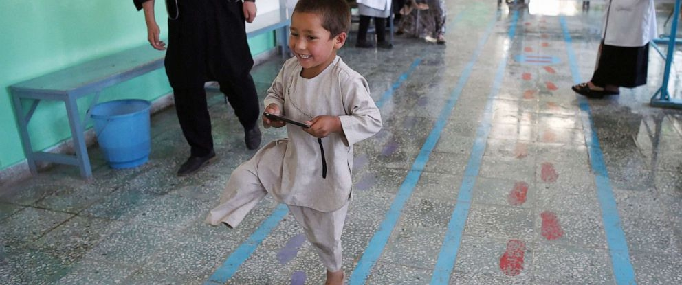 PHOTO: Ahmad Rahman, an Afghan boy who lost his right leg when he got caught in the crossfire walks with his prosthetic leg at the International Committee of the Red Cross clinic in Kabul on May 7, 2019.