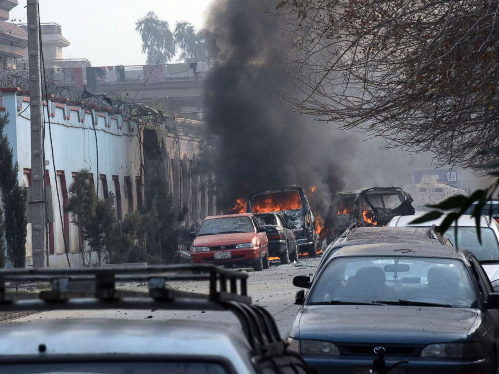 PHOTO: Vehicles burn after a deadly attack in Jalalabad, Afghanistan, Jan. 24, 2018