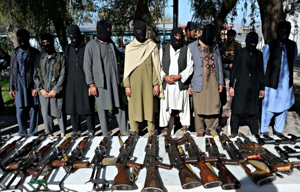 PHOTO: Alleged Taliban fighters and other militants stand handcuffed while being presented to the media at police headquarters in Jalalabad, Afghanistan on March 6, 2018.