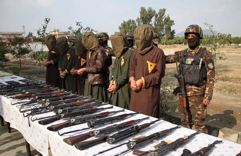 PHOTO: Afghanistans National Directorate Security (NDS) escort a group of suspected militants who are accused of planning attacks on government and security forces after their arrest in Jalalabad, Afghanistan, Jan. 23, 2019.