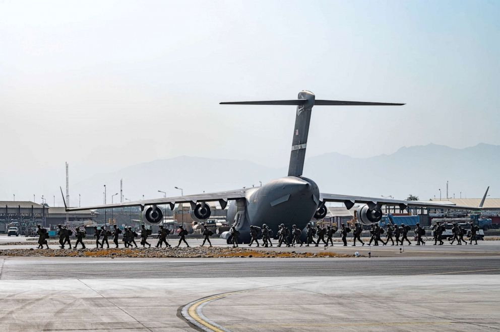 PHOTO: U.S. soldiers arrive to provide security in support of Operation Allies Refuge at Hamid Karzai International Airport in Kabul, Afghanistan, Aug. 20, 2021.