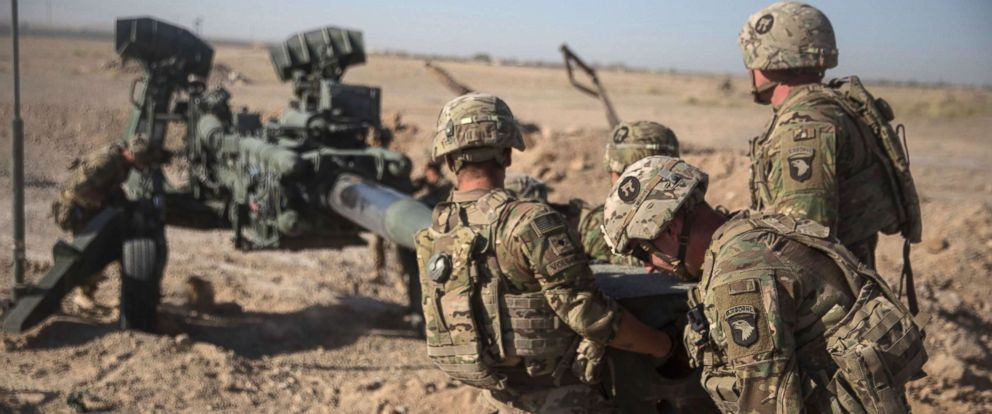 PHOTO: U.S. Soldiers with Task Force Iron maneuver an M-777 howitzer, so it can be towed into position at Bost Airfield, Afghanistan, June 10, 2017.