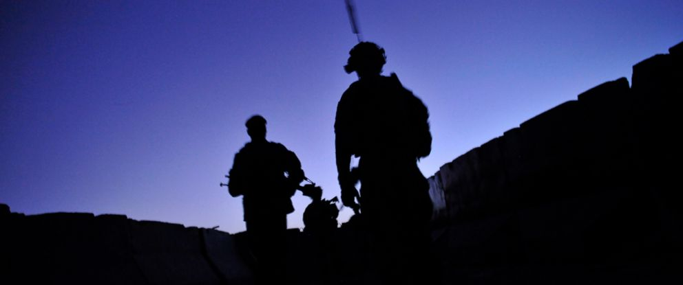 PHOTO: U.S. troops under Afghanistans International Security Assistance Force, and Afghan National Army soldiers conduct a joint security dawn patrol in the center of Kandalay village in Kandahar, Afghanistan, Aug. 4, 2011.