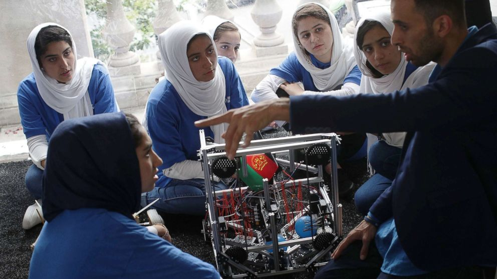 Clockwise from lower left, Yasimin Yasinzadah, Lida Azizi, Rodaba Noori, Fatemah Qaderyan, Kawsar Roshan, and Somayeh Faruqi of Team Afghanistan listen to coach Alireza Mehraban during the first of two days of the First Global International Robot Olympics, an international robotic challenge, July 17, 2017 at DAR Constitution Hall in Washington, D.C.