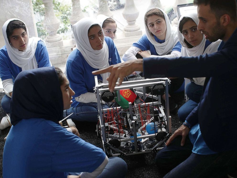 PHOTO: Team Afghanistan listen to coach Alireza Mehraban during the first of two days of the First Global International Robot Olympics, an international robotic challenge, July 17, 2017 at DAR Constitution Hall in Washington, D.C.