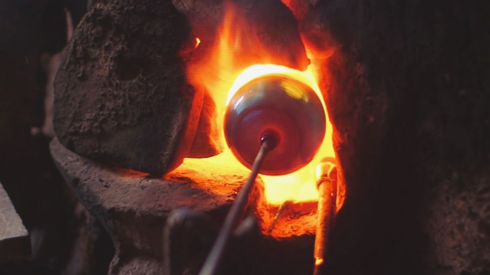 A glassblower practices his craft in the western Afghanistan city of Herat.