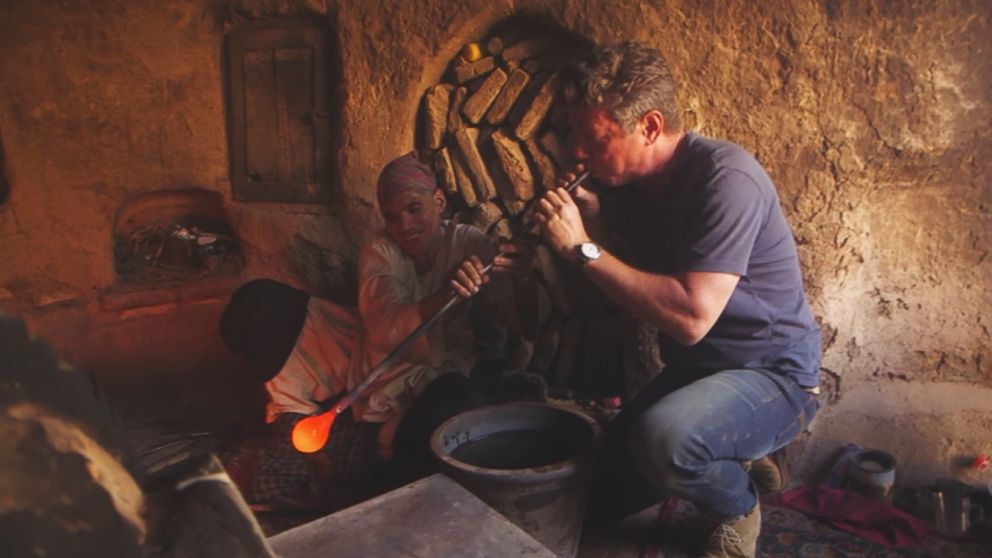 PHOTO: A glassblower gives ABC News Ian Pannell a try at blowing glass in a workshop in the western Afghanistan city of Herat.