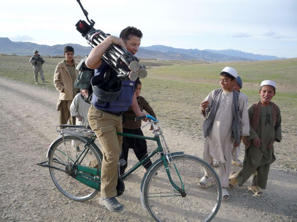 PHOTO: ABC News Senior Foreign Correspondent Ian Pannell borrows a childs bicycle in Afghanistan in 2009.