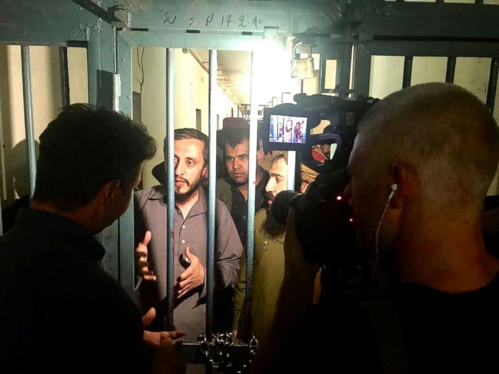 PHOTO: ABC News Senior Foreign Correspondent Ian Pannell and photographer James Gillings interview imprisoned Taliban fighters outside Kabul, Afghanistan, in June 2018.