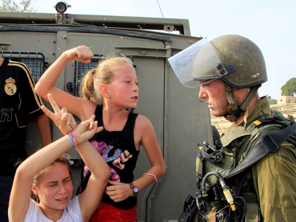 PHOTO: A file photo from Nov.2, 2012 shows Palestinian girl Ahed al-Tamimi (C) challenging Israeli soldiers during a protest in Ramallah, West Bank.