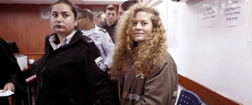 PHOTO: Sixteen-year-old Palestinian Ahed Tamimi, a well-known campaigner against Israels occupation, stands for the beginning of her trial in the Israeli military court at Ofer military prison in Betunia, Israel Feb. 13, 2018.