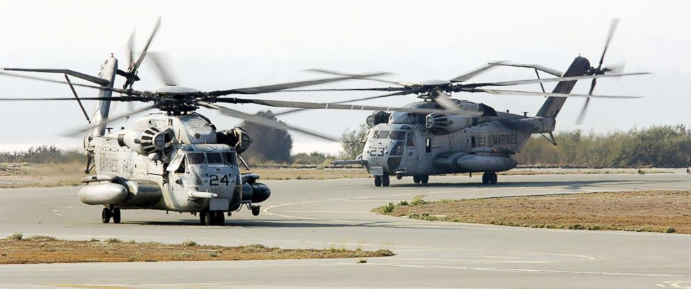 PHOTO: Two U.S. Marine Corps CH-53 Super Stallion helicopters taxi to the parking ramp at Royal Air Force Base Akrotiri in Cyprus following their flight from the U.S. Embassy in Beirut, Lebanon, on July 16, 2006.