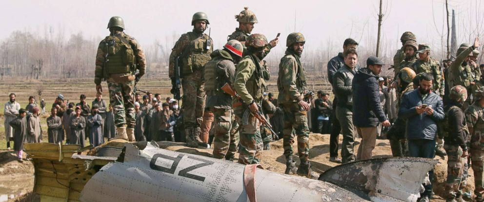 PHOTO: Indian soldiers stand next to the wreckage of an Indian Air Force helicopter after it crashed in Budgam district in Kashmir Feb. 27, 2019.