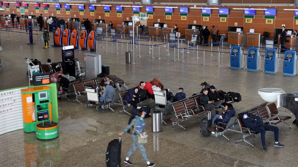 Passengers at Sheremetyevo International Airport on the first day of an international flight ban ordered by the government amid the ongoing COVID-19 pandemic and effective since March 27.Marina Lystseva/TASS/Newscom