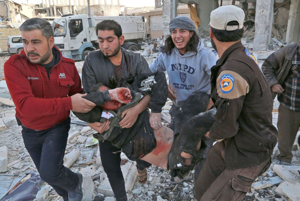PHOTO: Syrian men carry a wounded man following a reported airstrike on the rebel-held town of Atareb in Syrias northern Aleppo province, Nov. 13, 2017.