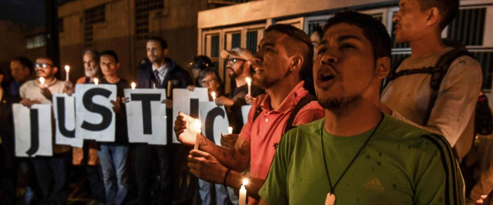 PHOTO: Opponents of Venezuelan president Nicolas Maduro demonstrate in front of the building of the intelligence service, SEBIN, where it is alleged that opposition councilor Fernando Alban committed suicide, in Caracas, Oct. 8, 2018.