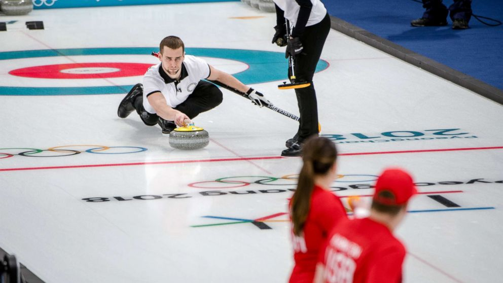 The Russian athletes Aleksandr Krushelnitcki and Anastasia Bryzgalova in action against the American siblings Matt and Becca Hamilton, backs to camera, in the mixed doubles curling event at the Gangneung Curling Center in Gangneung, South Korea, Feb. 8, 2018.