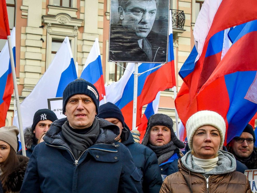 PHOTO: Russian opposition leader Alexey Navalny (L) and his wife Yulia (R) attend an opposition march in memory of murdered Kremlin critic Boris Nemtsov in central Moscow, Feb. 25, 2018.