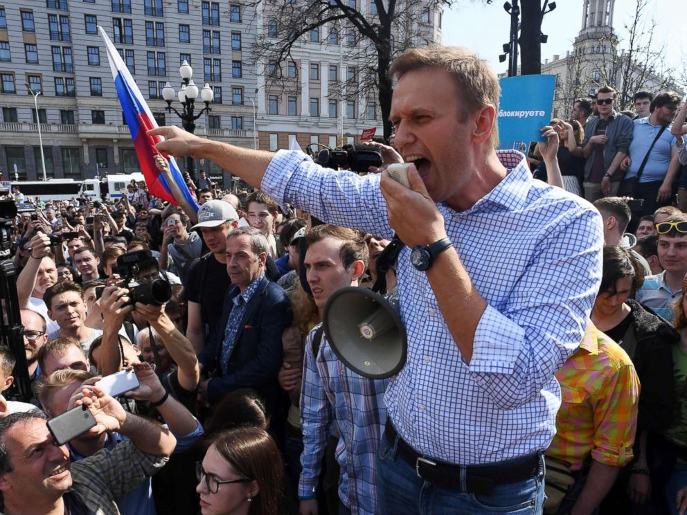 PHOTO: Russian opposition leader Alexei Navalny addresses supporters during an unauthorized anti-Putin rally on May 5, 2018 in Moscow, two days ahead of Vladimir Putins inauguration for a fourth Kremlin term.