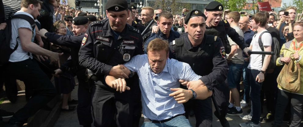 "PHOTO: Chairman of the Party ""Progress Party"" Alexei Navalny (center) is detained during a demonstration against President Vladimir Putin in Moscow, Russia, May 5, 2018."