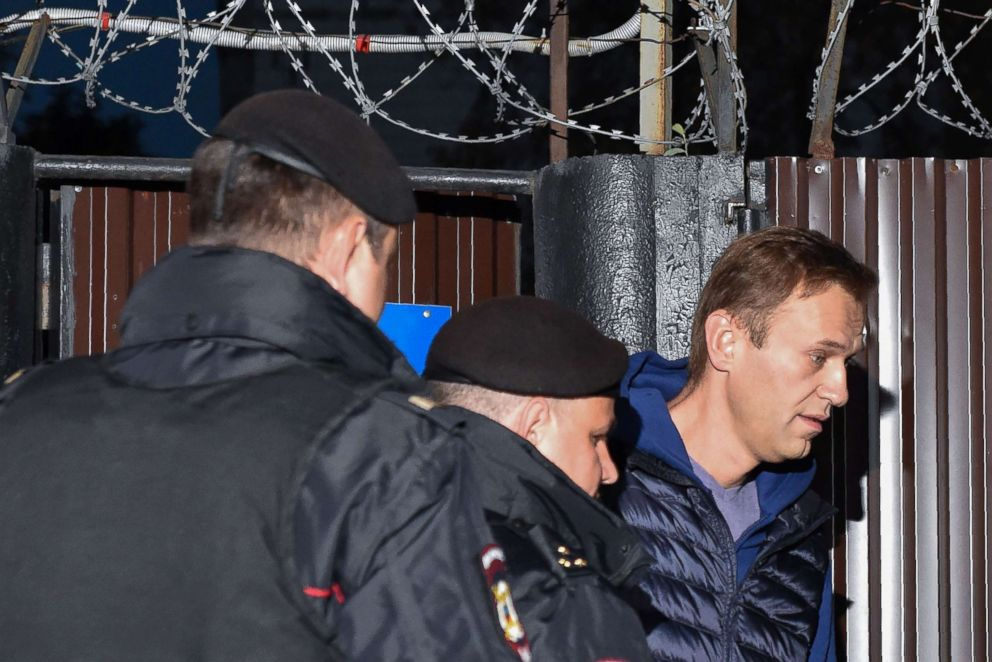 PHOTO: Russian police officers detain Alexei Navalny outside the detention center in Moscow on Sept. 24, 2018.