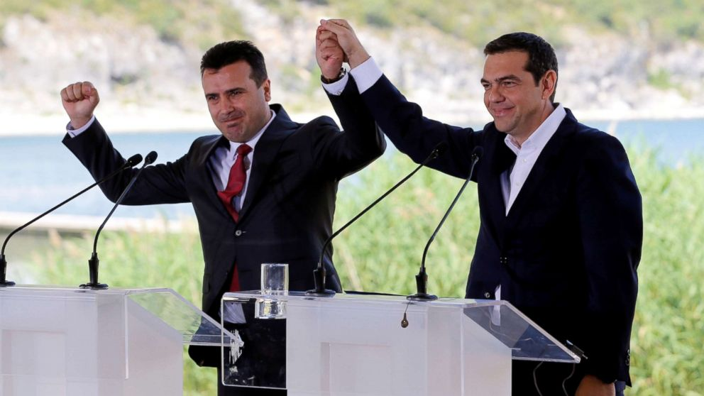 Greek Prime Minister Alexis Tsipras and Macedonian Prime Minister Zoran Zaev gesture before the signing of an accord to settle a long dispute over the former Yugoslav republic's name in the village of Psarades, in Prespes, Greece, June 17, 2018.