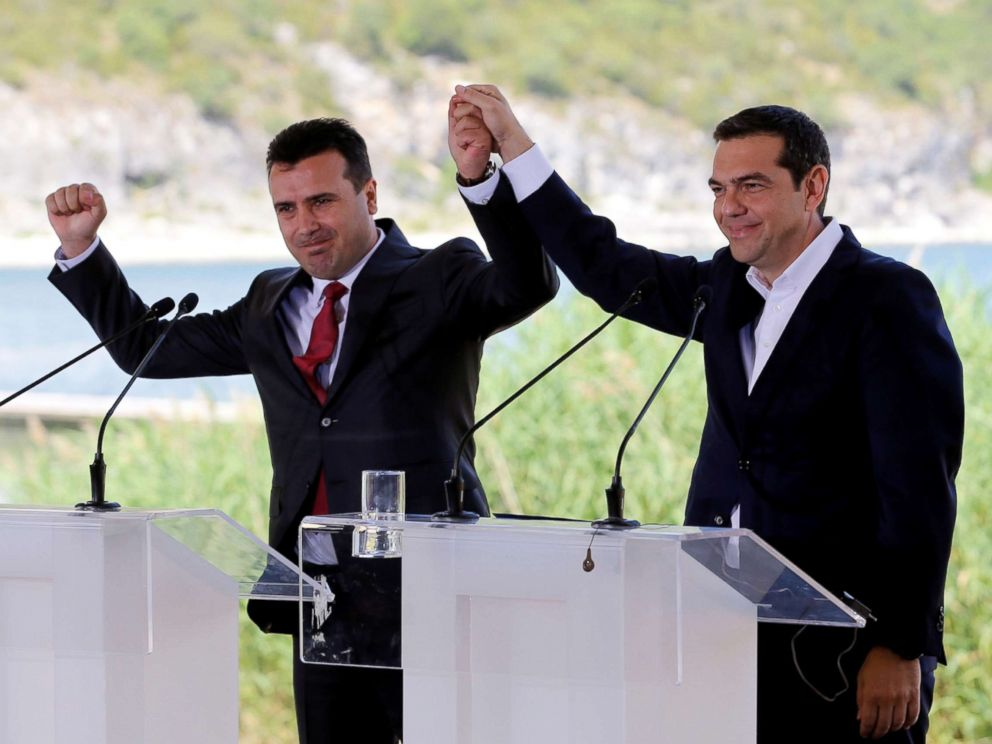 PHOTO: Greek Prime Minister Alexis Tsipras and Macedonian Prime Minister Zoran Zaev gesture before the signing of an accord to settle a long dispute over the former Yugoslav republics name in the village of Psarades, in Prespes, Greece, June 17, 2018.  Greece and Macedonia hope to end decades-long dispute over name alexis tsiprias zoran zaev rt jt 180617 hpMain 4x3 992