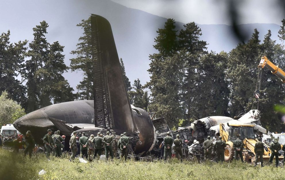 PHOTO: Rescuers are seen around the wreckage of an Algerian army plane which crashed near the Boufarik airbase from where the plane had taken off on April 11, 2018.
