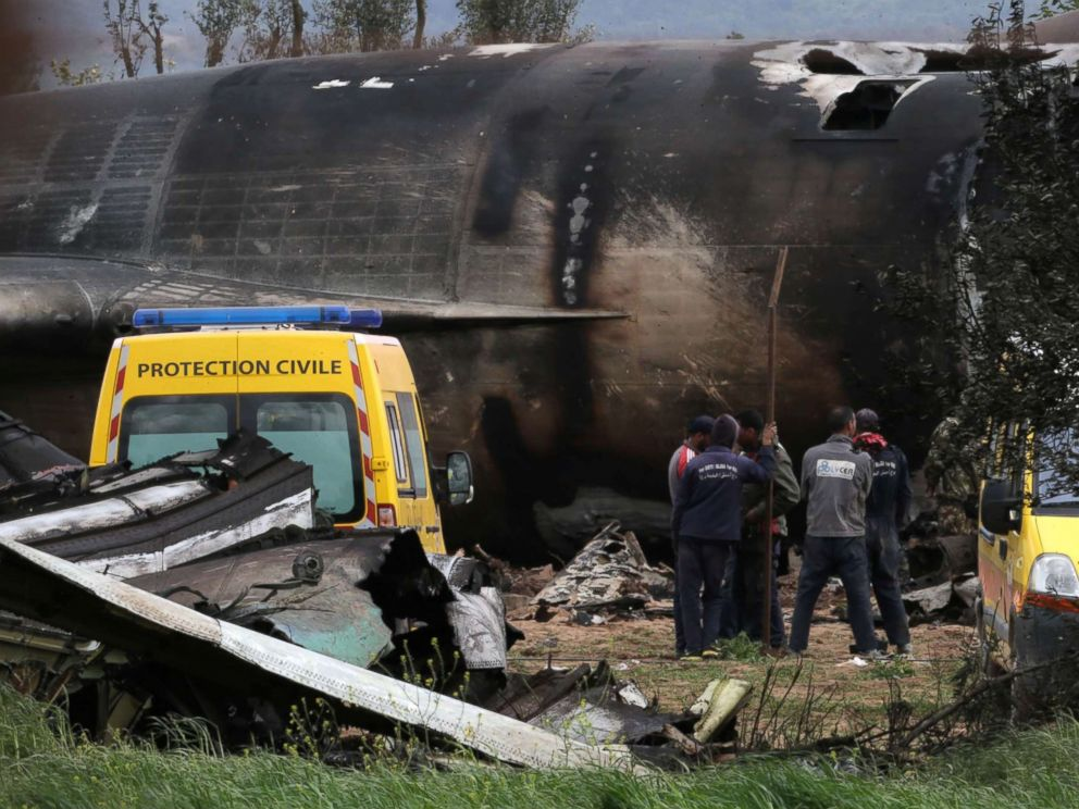 PHOTO: Algerian rescuers stand next to the wreckage of a military transport aircraft that crashed in Boufarik, near the Algeria capitol, Algiers, April 11, 2018.