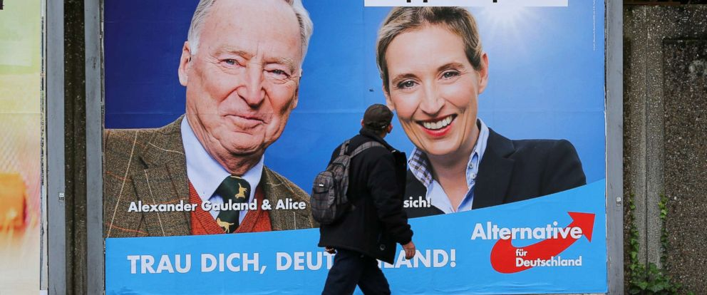 PHOTO: A man looks at at a placard of Alexander Gauland and Alice Weidel, the top candidates of Germanys anti-immigration party Alternative fuer Deutschland (AfD), in Marxloh, a suburb of Duisburg, on Sept. 13, 2017.