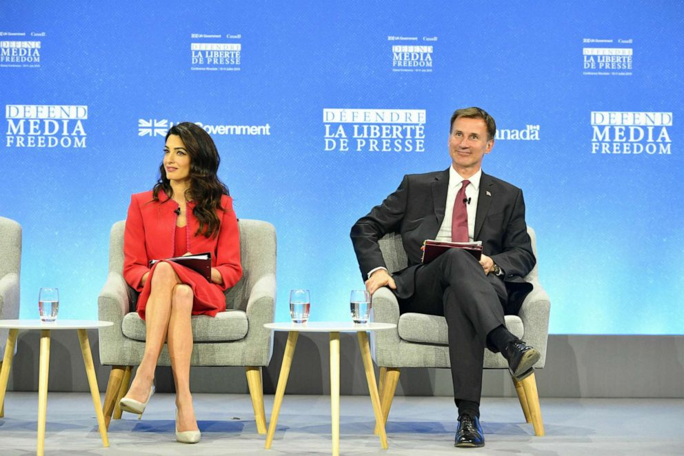 PHOTO: Amal Clooney and Britains Foreign Secretary Jeremy Hunt during the Global Conference for Media Freedom in London, July 10, 2019.