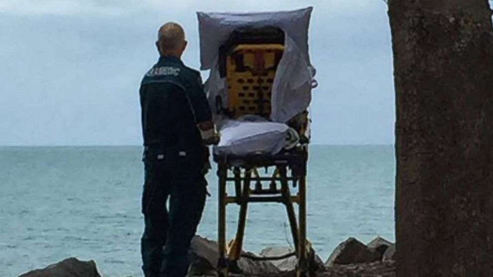 The Queensland Ambulance Service posted this photo to their Facebook after granting a terminally ill woman in Australia her final wish to go to the beach.