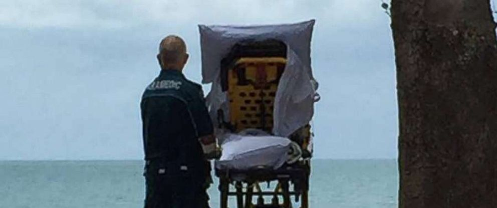 PHOTO: The Queensland Ambulance Service posted this photo to their Facebook after granting a terminally ill woman in Australia her final wish to go to the beach.