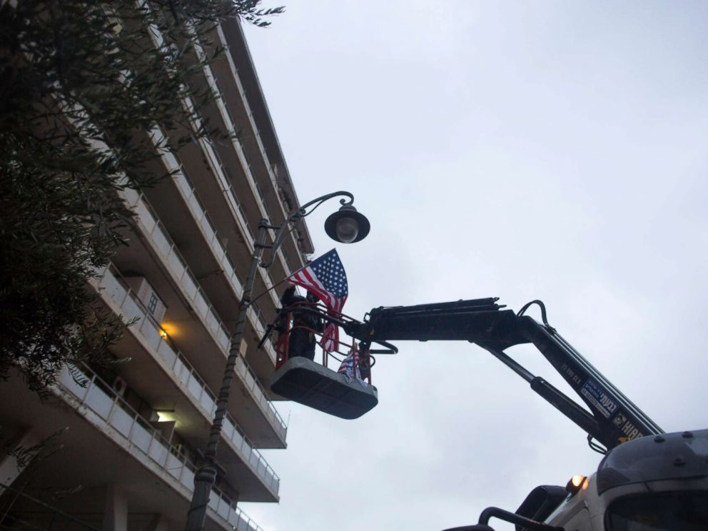 PHOTO: A municipal employee hangs an American flag next to the U.S. Consulate on Dec. 6, 2017 in Jerusalem, Israel.