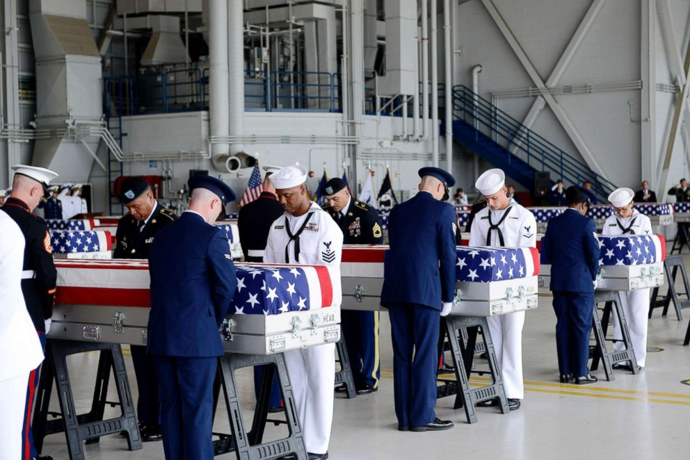 PHOTO: Military honor guards carry the remains of American soldiers repatriated from North Korea during a repatriation ceremony after arriving to Joint Base Pearl Harbor-Hickam, Honolulu, Aug. 1, 2018.