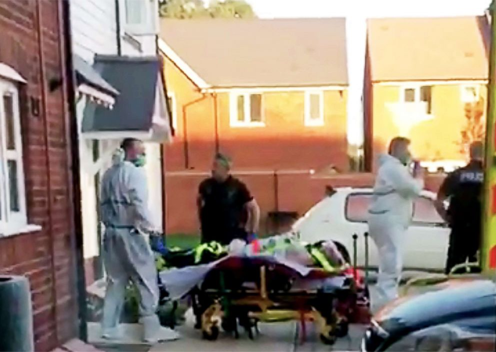 PHOTO: A still image taken from video footage recorded on June 30, 2018 shows a man on a stretcher being put into an ambulance by medics and police outside a residential address in Amesbury, southern England, on June 30, 2018.
