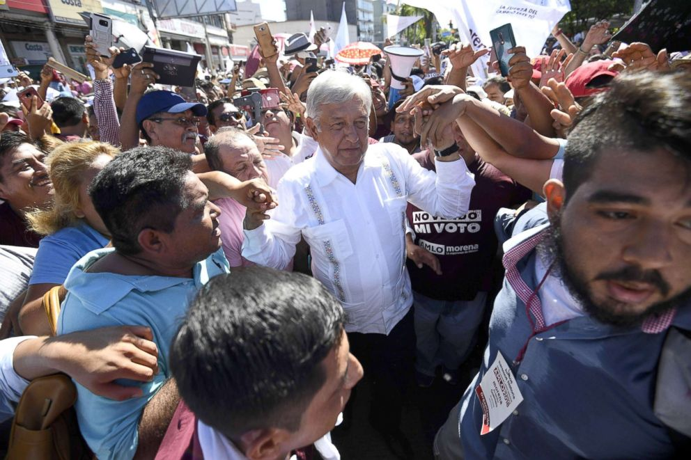 PHOTO: Ahead of the July 1 presidential election, Mexicos presidential candidate for the MORENA party, Andres Manuel Lopez Obrador, greets supporters during a campaign rally in Acapulco, Guerrero State, Mexico, on June 25, 2018.