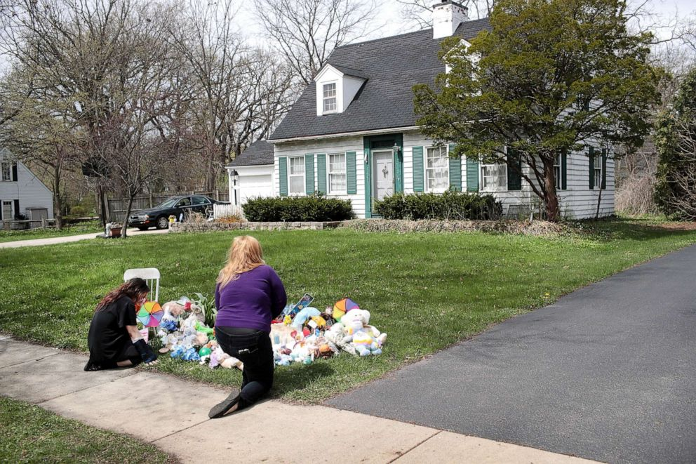 PHOTO: People pray next to a small memorial that sits outside the home of five-year-old Andrew A.J. Freund on April 24, 2019, in Crystal Lake, Ill.