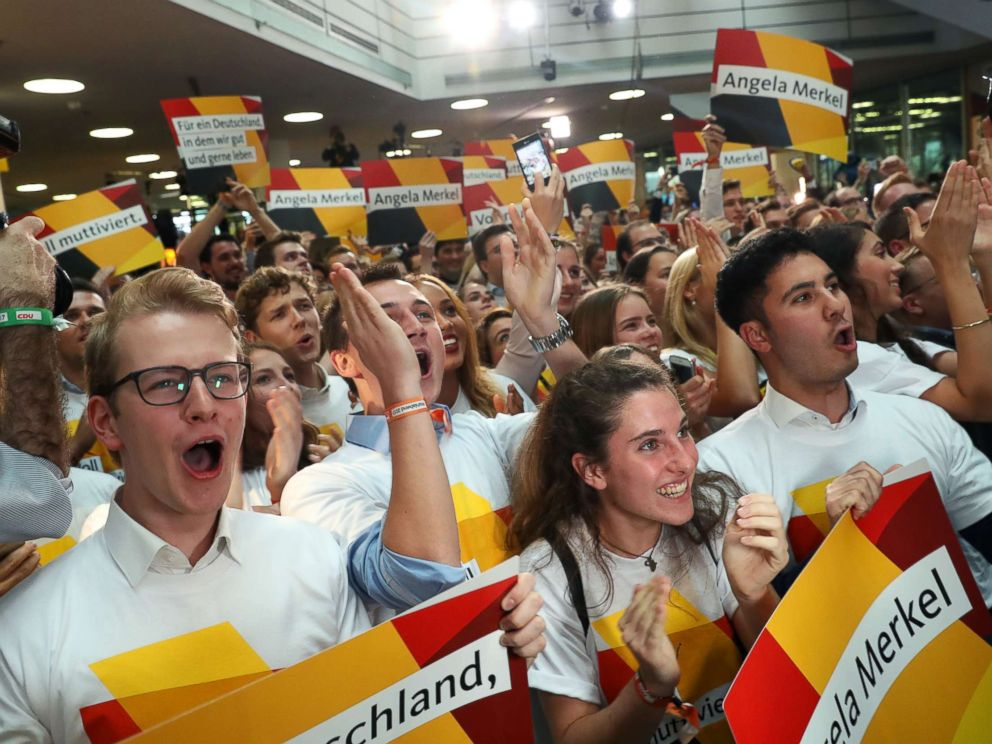 PHOTO: Supporters of the German Christian Democrats (CDU), the party of German Chancellor Angela Merkel, cheer while waiting for the initial results in German federal elections, Sept. 24, 2017 in Berlin, Germany.