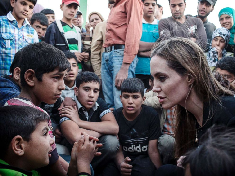 PHOTO: UNHCR Special Envoy Angelina Jolie speaks with Syrian refugees in a Jordanian military camp based near the Syria/Jordan border, June 18, 2013.
