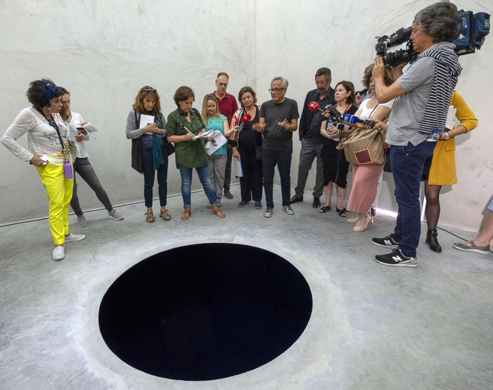 PHOTO: Anish Kapoor talks to journalists inside the cube structure of Descent into Limbo during the presentation to the press of his exhibition Anish Kapoor: Works, Thoughts, Experiments in Serralves Museum and Park, in Porto, Portugal, July 6, 2018.