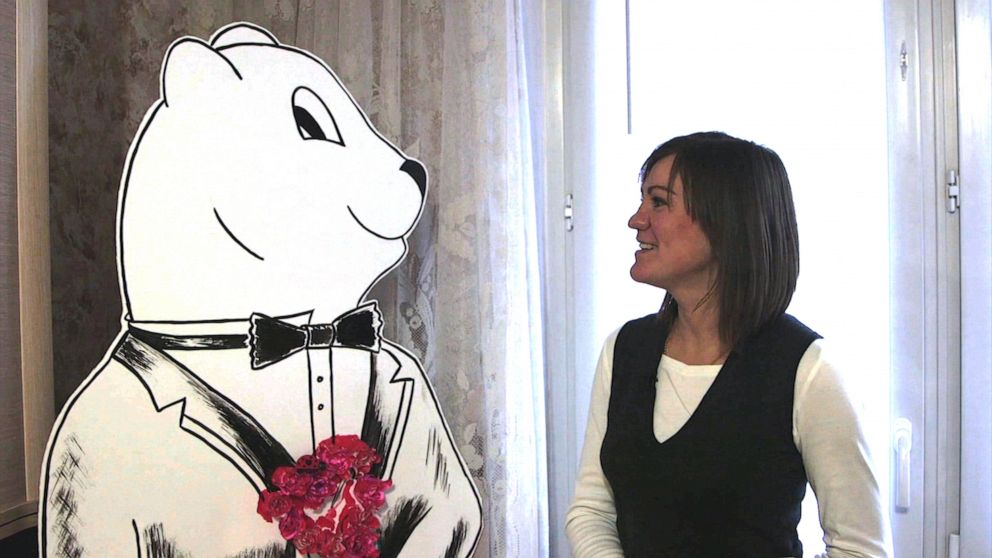 PHOTO: Anna Grandstaff at her home in Moscow with life-sized drawing of Gaylens bear.