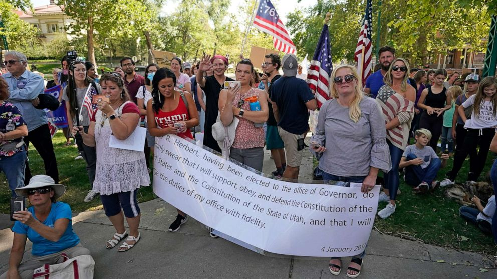 PHOTO: People protest Gov. Gary Herbert during an anti-mask rally outside of the Governors Mansion on Sept. 12, 2020, in Salt Lake City.